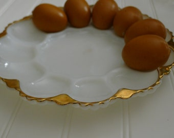 Milk glass egg dish with gold edging