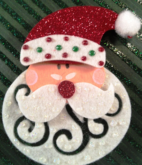 Whimsical Santa Face pin is made of felt. Makes great Teacher, office and secert santa gifts!
