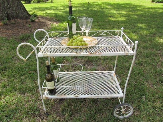 https://www.etsy.com/listing/162903206/vintage-tea-trolleymetal-cartshabby-chic?ga_order=most_relevant&ga_search_type=all&ga_view_type=gallery&ga_search_query=v2%20v2team%20garden%20decor&ref=sr_gallery_2