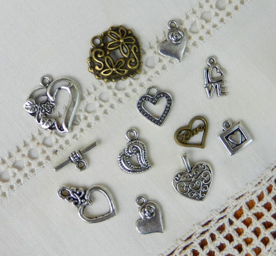 items similar to 11 different charms pendant