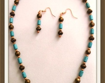 Classy 19 in Turquoise colored Howlite and Copper Necklace and Earrings Set One of a kind  Warm and rich in color this set  oozes confidence
