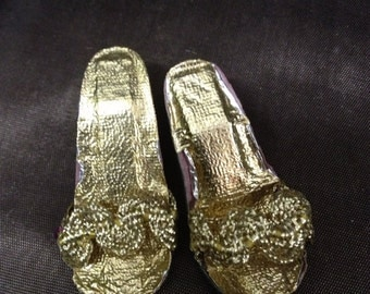 Doll high heel shoes.