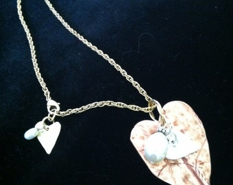 Necklace is made of sterling,copper and fresh water pearls with a vintage4 sterling chain.