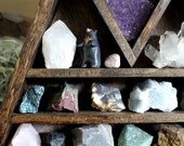 Large Crystal and Mineral collection in handmade elongated wood triangle shelf along with HandyMaiden Bear Sculpture