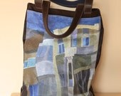 Art on your bag! Large bag in distressed leather with two large outer pockets.