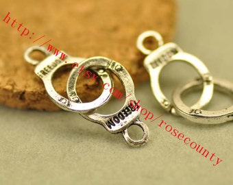 wholesale 100pcs 30x10mm antiqued silver Freedom handcuff charms findings