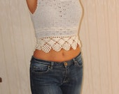 A lovely blue and white knitted coachella top with white crochet trim
