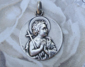 Antique religious medal young St. John the baptist and Agnus dei