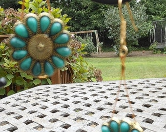 Beautiful turquoise daisies dangle earrings