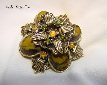 Stunning Mid Century round brooch.  Variegated greens and yellows,  colored rhinestone.