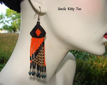 Long dangle tribal earrings on silver plated wires.  Choose a color, orange, yellow or blue.    Perfect example of beautiful beadmanship.