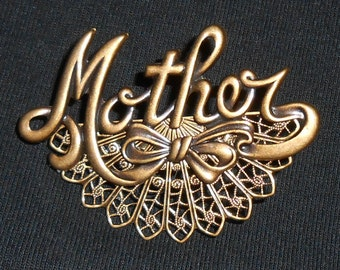 Loving antique gold Mother pin.