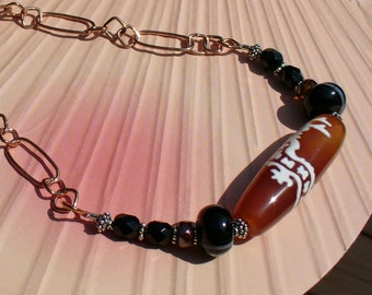 Artisan made carnelian necklace in the Asian style.