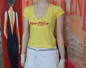 Womens yellow vee neck cap sleeve teeflirt with print on front