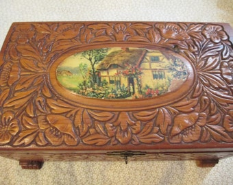 Carved Wooden Chest with Cottage Scene on Top