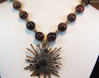 Tatiana: spectacular pendant on a necklace of brown and black striped agate beads