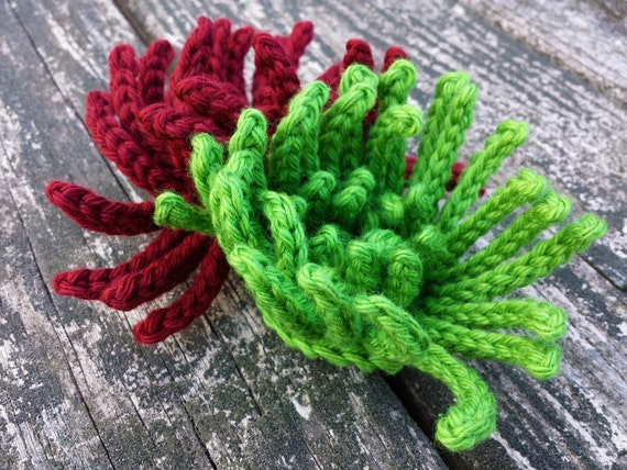 Crochet pattern bubble dog scarf shown in orange and for Spider plant dogs