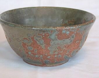 Wheel thrown, terracotta bowl with gunmetal green glaze 7x3 1/2
