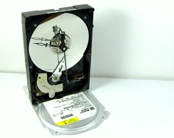 Regal hands desk clock from repurposed Western Digital hard drive