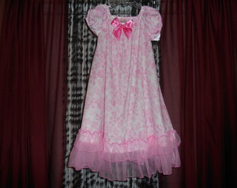Girls cute nylon nightgown in white with pink toile look.  Gown has little puffed sleeves.  She would look like a princess.