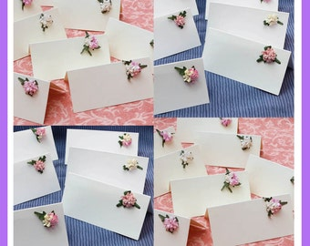 Wedding place name cards. Beautiful floral decoration. Packs of 10. White or Ivory.