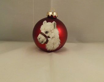 Alpaca painted on red glass Christmas Ornament