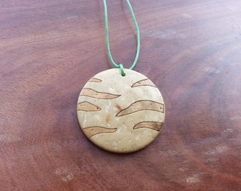 striped plant fibre pendant with green cord