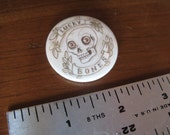 One Lucky Bones Skull pin-back button