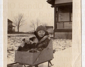 """Antique Photo """"It's Too Cold Outside"""" Little Boy Bundled up in a Home Made Basket for a Sled - He Looks Cold and Uncertain"""