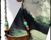 hammered brass necklace with turquoise, black agate, and red aventurine