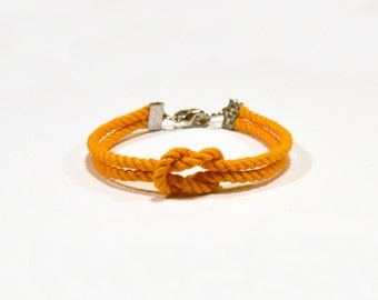 Matte orange forever knot nautical rope bracelet with silver or gold anchor charm