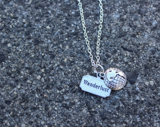 Wanderlust, World globe, Silver travel necklace.
