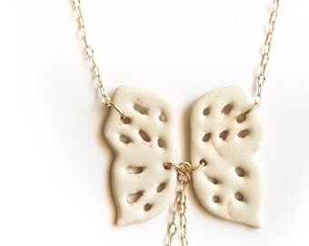 gift handmade porcelain jewelry butterfly necklace in beautiful cream shino glaze