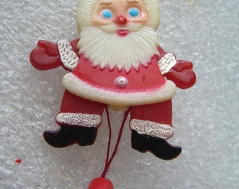 Vintage Santa Claus pin brooch with movable arms and legs early plastic pin brooch