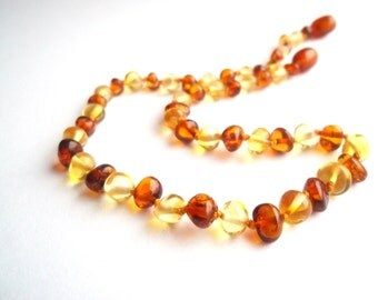 Baroque Baltic Amber Baby  Teething Necklace. Cognac and Lemon colors.