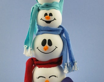 Four Wooden Snowman Heads with Floppy Hat and Scarves