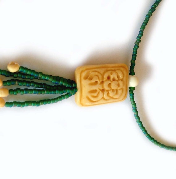 Green Beaded Necklace With Rectangular Carved Bone Flower Bead With Beaded Fringe