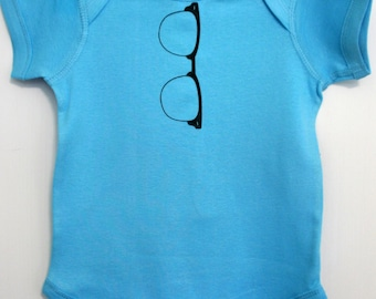 Horn Rimmed Nerdy Glasses Onesie Pictured on Turquoise