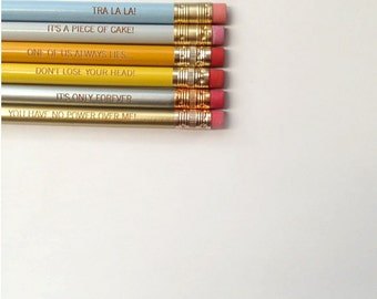 labyrinth pencil set of 6.  cannot be sold individually. piece of cake, tra la la, one of us always lies, only forever