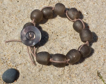 Mauve Purple Beach Glass Bracelet with an Antique Mother of Pearl Button