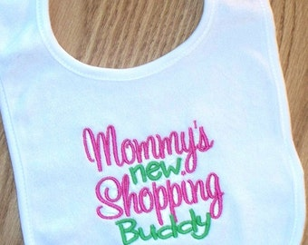 Baby Girl Bib - Mommy's new Shopping Buddy Embroidered Saying