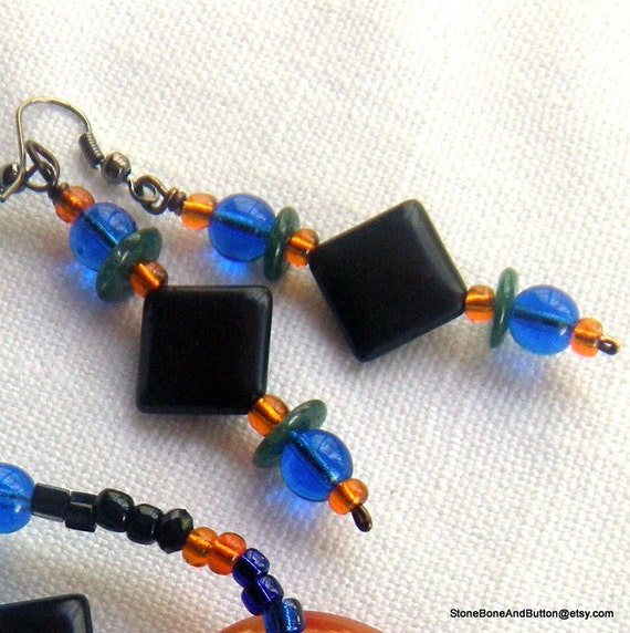 Earrings, Jeweltone Dangle, Blue, Green, Orange and Black. Diamond shape opaque black stones with transparent blue, orange and green