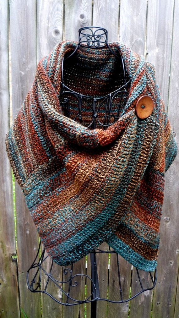 Crocheted wrap in colors of Arizona with brown button