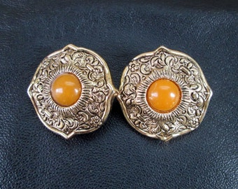 Ornate statement earrings, vintage orange Lucite antique gold tone clip-on earrings