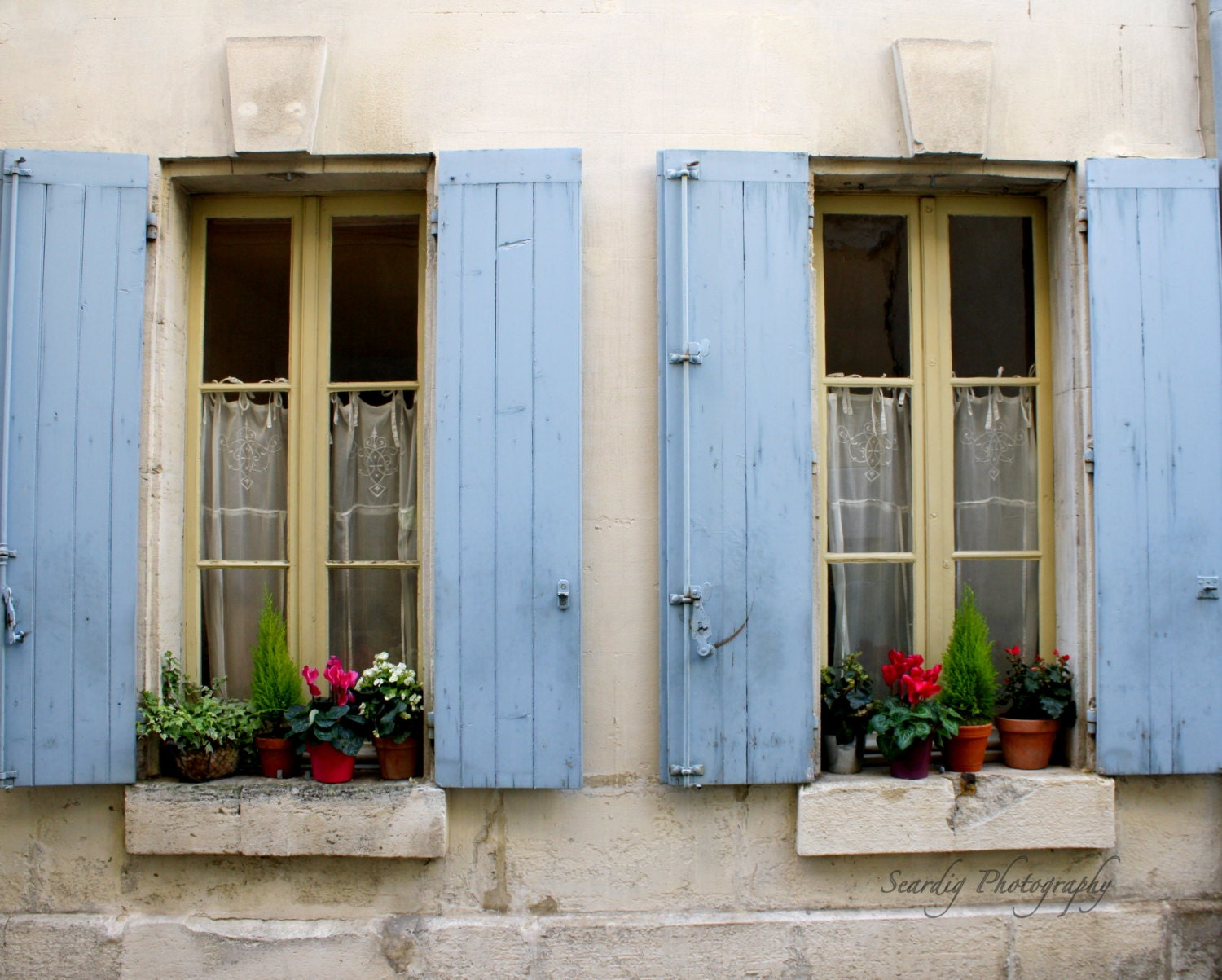 St remy de provence france rustic french window shutters for Decorating with old windows and shutters