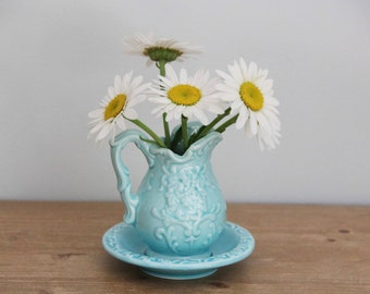 Aqua blue mini ceramic pitcher / creamer and saucer