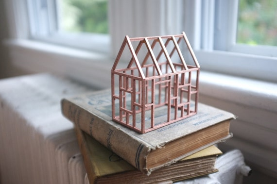 Small rose gold birch frame house - exposed painted wood structure - copper color architecture - geometric