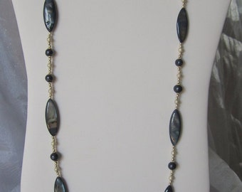 This is a beautiful long Abalone mother of pearl shell beads with blue pearl beaded necklace matching erring set