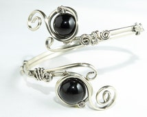 Adjustable upper arm bracelet with 2 black Onyx gemstones.