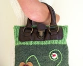 Stylish knitted handbag green with lighter green trim, re-cycled handles and heart design